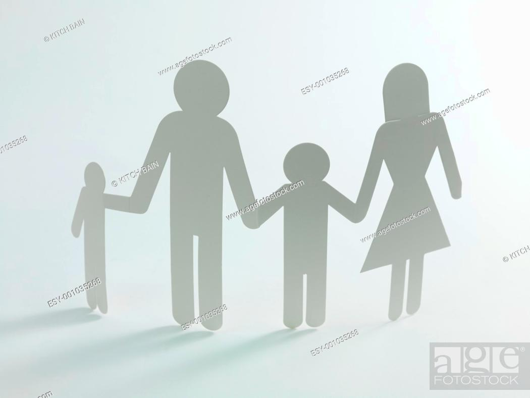 Stock Photo: A family cutout shape isolated against a white background.