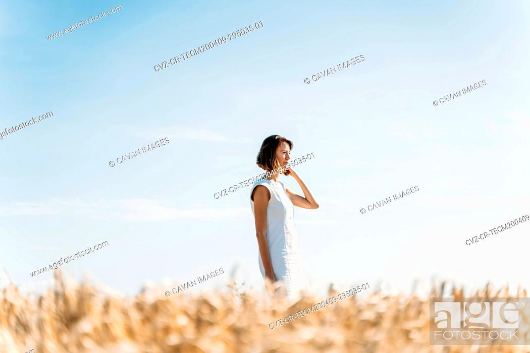 Stock Photo: portrait of a caucasian woman in the country during the summer.