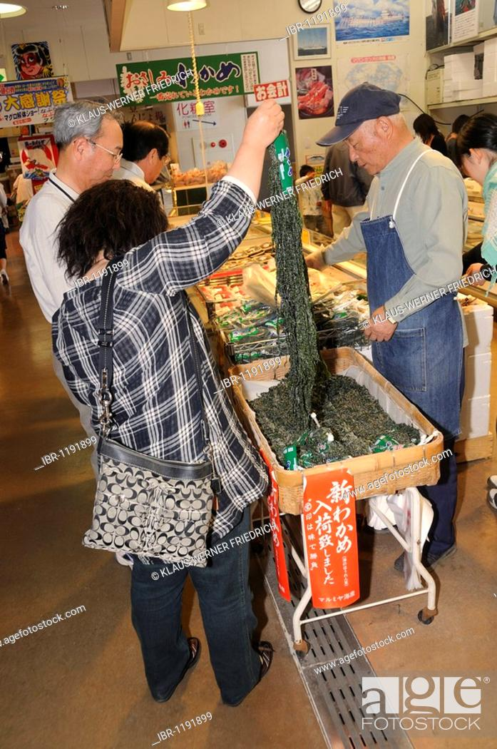 People buying Nori, seaweed, for Japanese food, in a large market