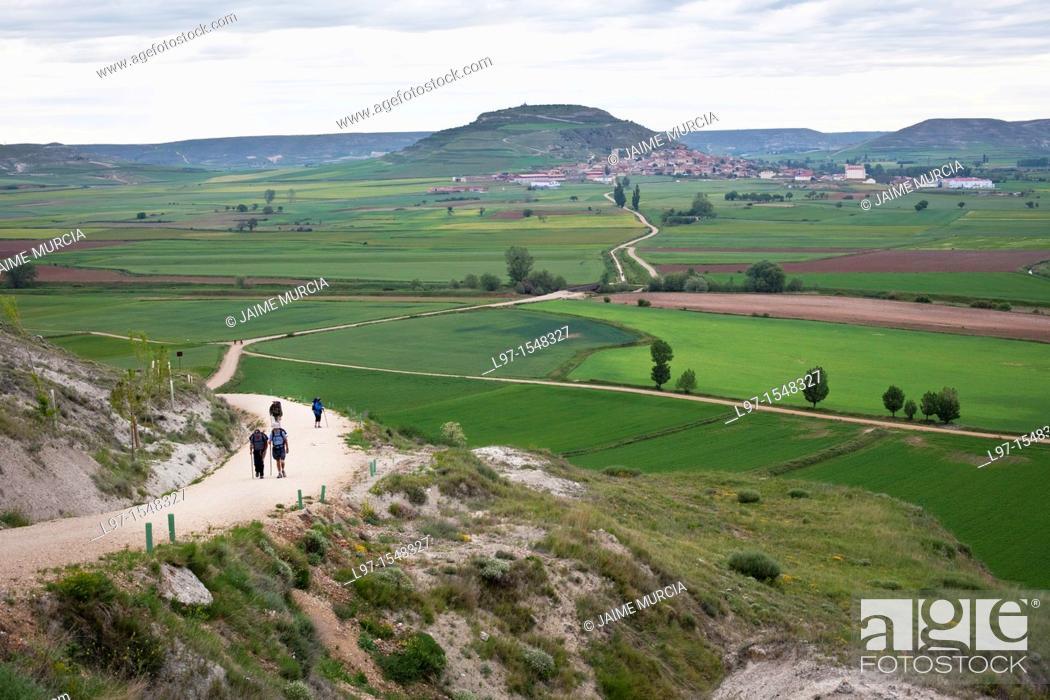 Stock Photo: Pilgrims on the Camino de Santiago, near the village of castrojeriz.