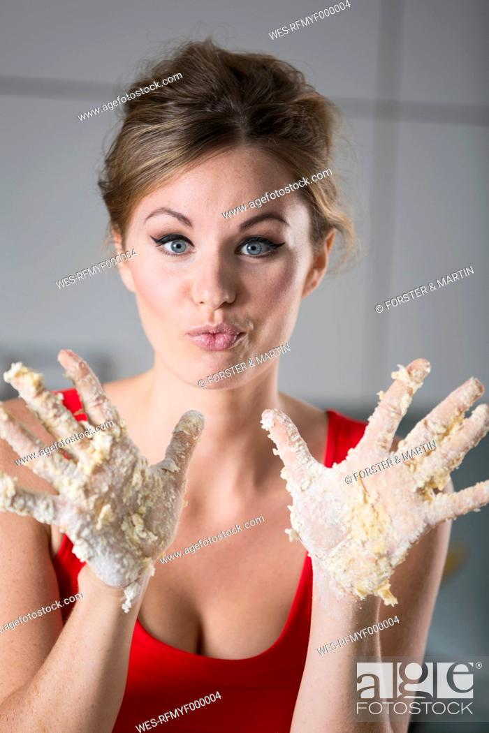 Stock Photo: Germany, Young woman hands covered with batter.