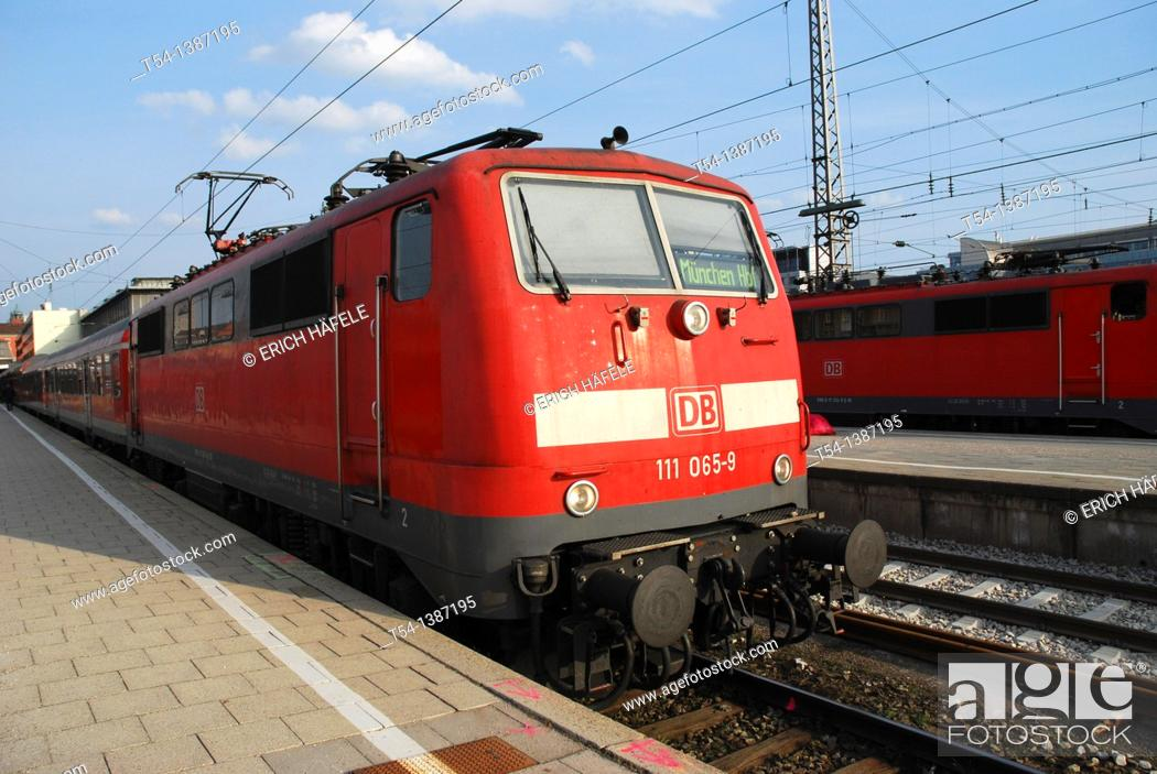 Stock Photo: Electric locomotive class 111 in Munich station in a regional express train.