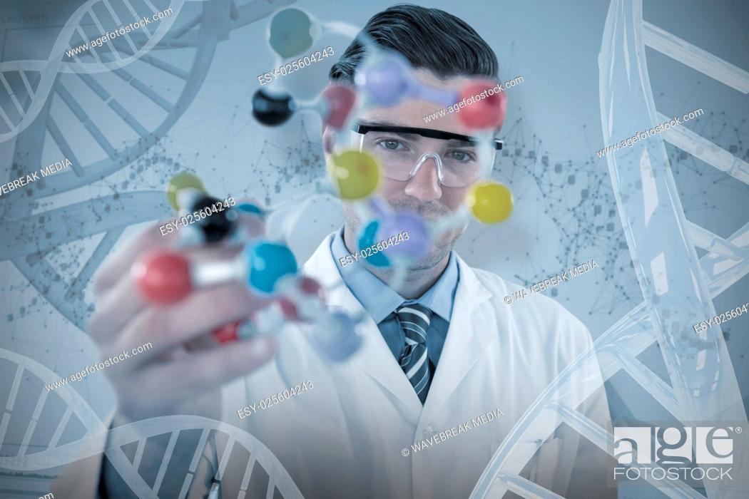Stock Photo: Composite image of portrait of scientist holding molecule structure.