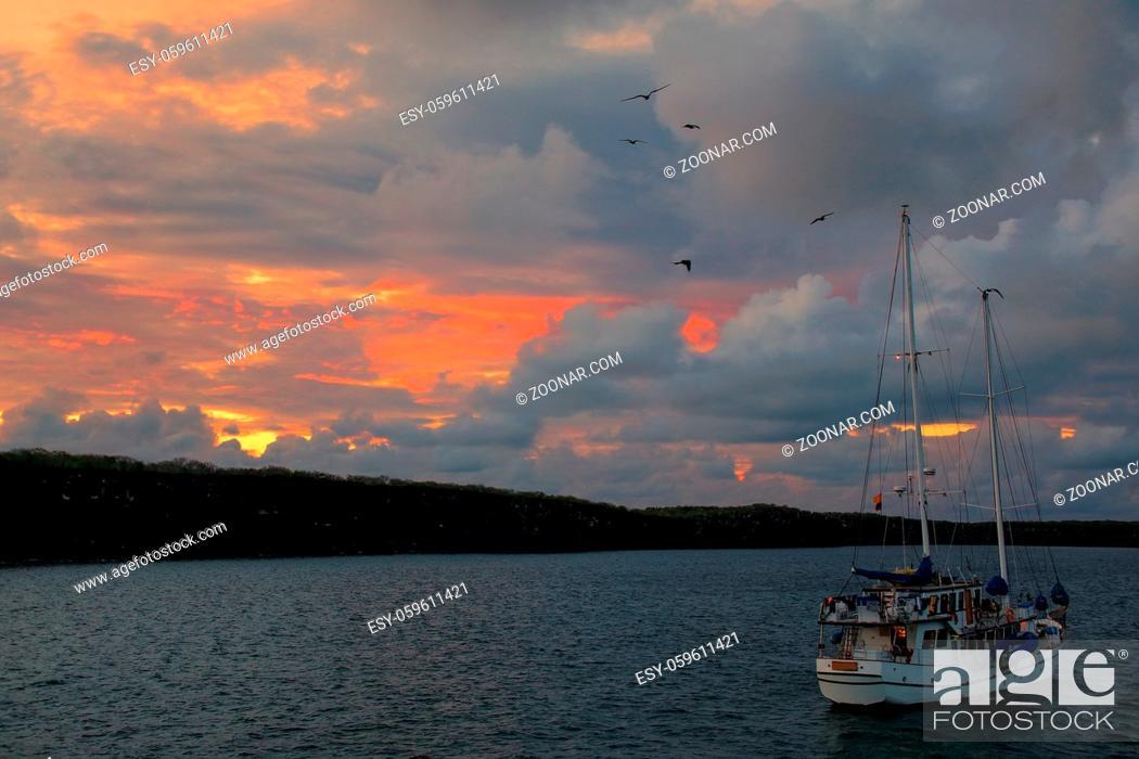 Stock Photo: Sailboat at sunrise in Great Darwin Bay, Genovesa Island, Galapagos National Park, Ecuador.