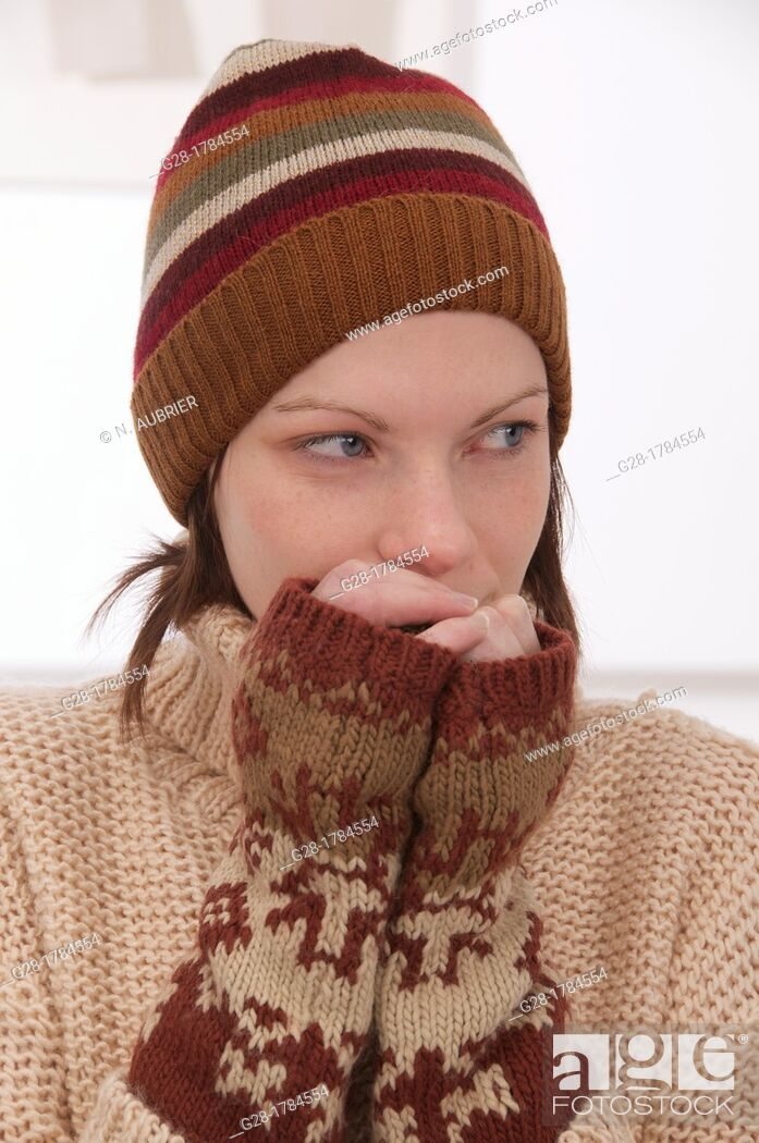 Stock Photo: Young beautiful woman in winter woolen hat and mittens.