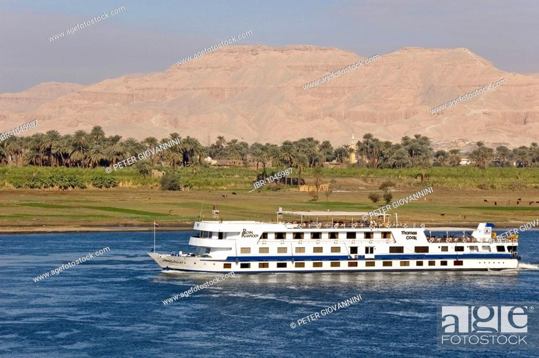 Stock Photo: View of West Thebes over the Nile with cruise ship, Luxor, Egypt, Africa.