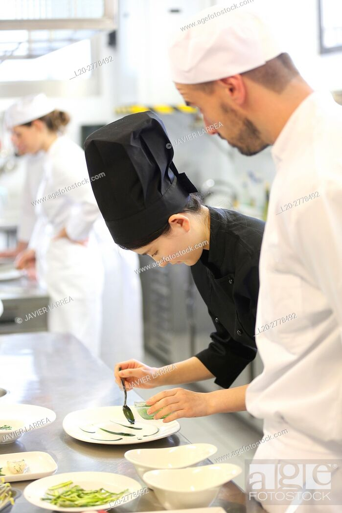 Stock Photo: Chefs, Cooks in cooking school, Cuisine School, Donostia, San Sebastian, Gipuzkoa, Basque Country, Spain, Europe.
