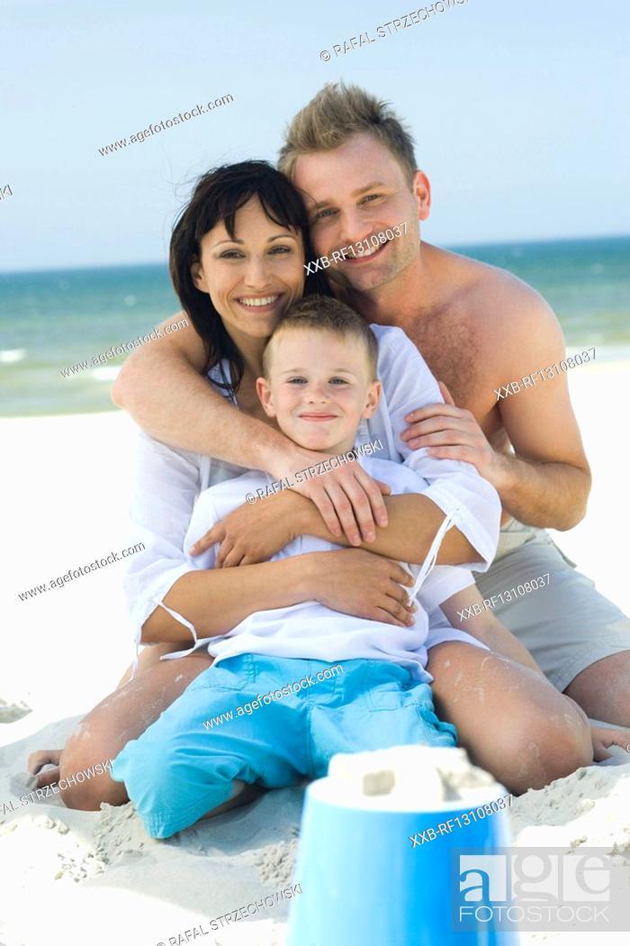 Stock Photo: family portrait on sea.
