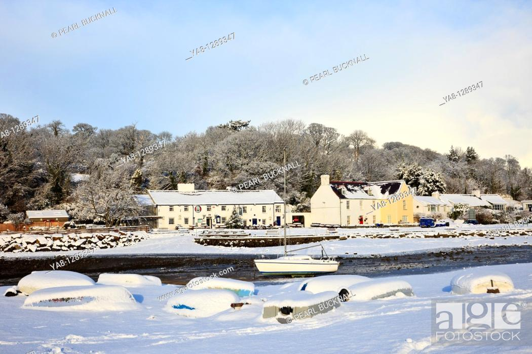 Stock Photo: Red Wharf Bay Traeth Coch, Isle of Anglesey, North Wales, UK, Europe  Snow scene with upturned boats on the coast in winter.