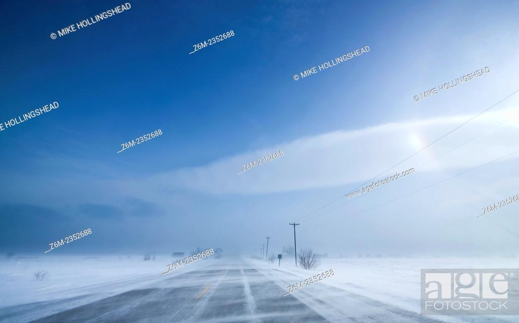 Stock Photo: Arctic air and wind driven snow and ice create vivid sun dogs and haloing over western Iowa.