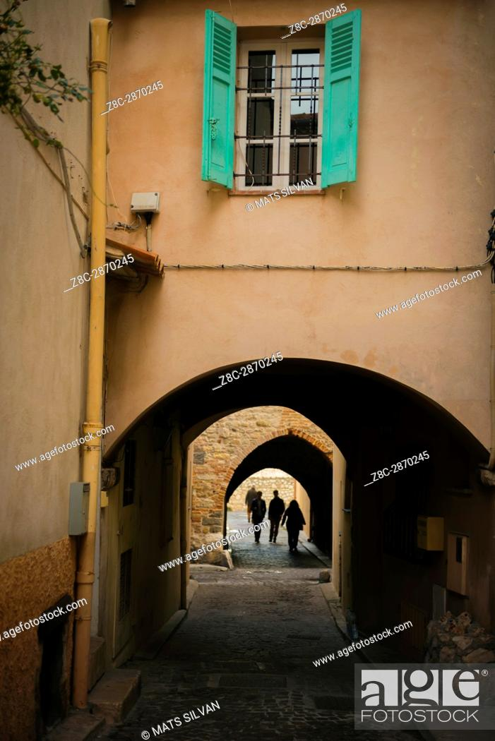 Stock Photo: Narrow Street Alley With Tunnel in Antibes in Provence-Alpes-Côte d'Azur, France.