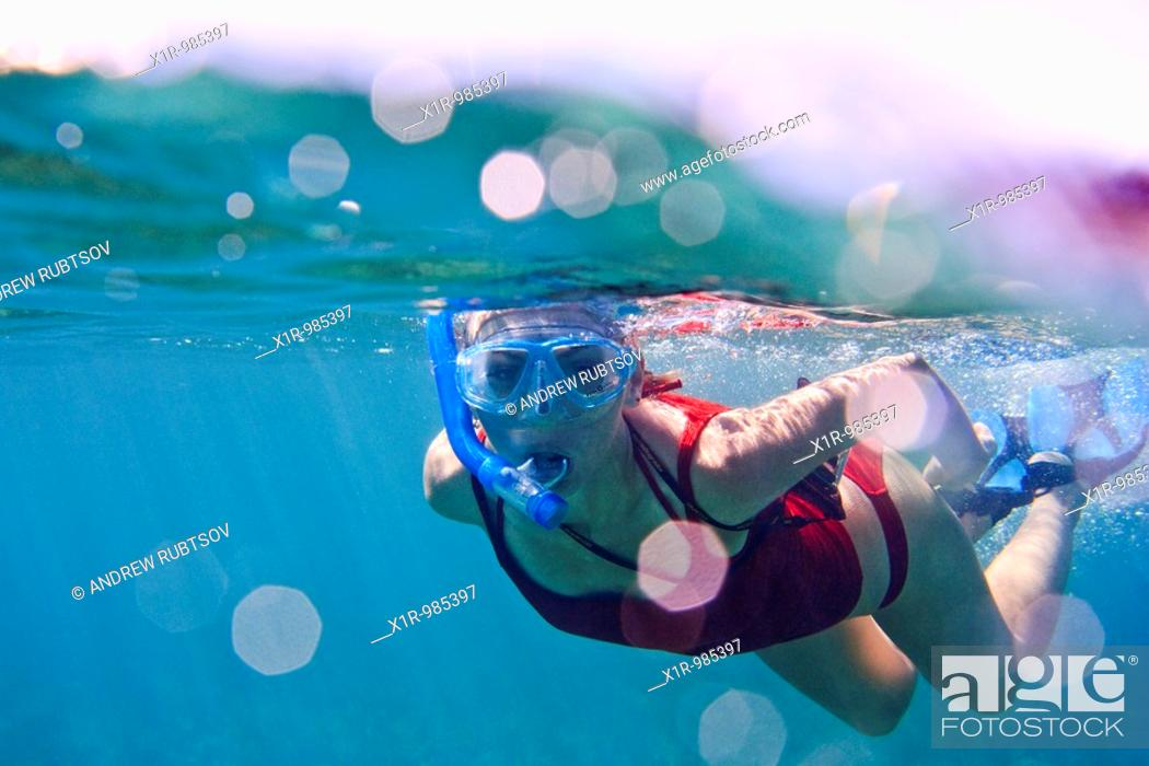 Stock Photo: Underwater view of a young woman snorkeling.