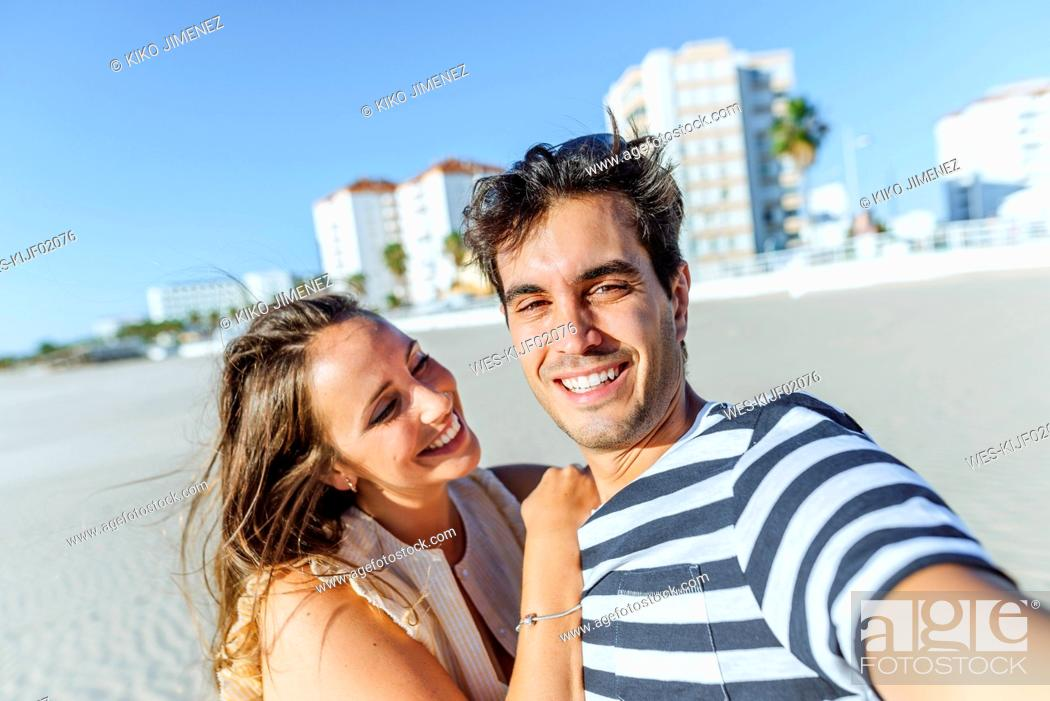 Photo de stock: Selfie of a happy young couple on the beach.
