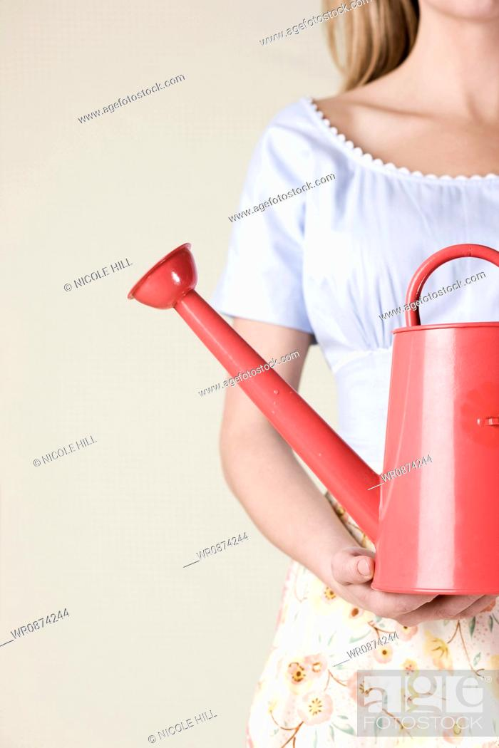 Stock Photo: woman with a watering can.
