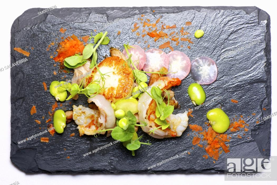 Stock Photo: Piglet sauteed with scallops and prawns.