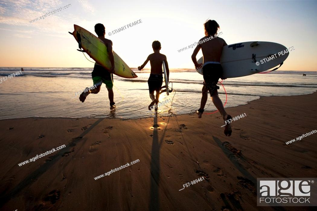 Stock Photo: Surfers in Costa Rica, Central America.