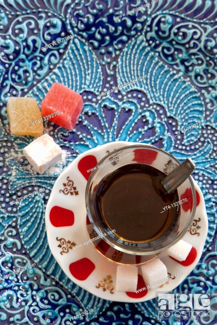 Stock Photo: A glass of Turkish Tea and Turkish Delight or Loukoum  Istanbul, Turkey.