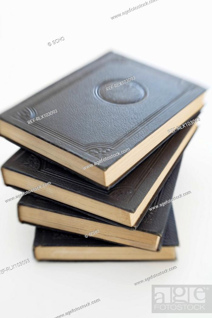 Stock Photo: Pile of four black school books, close-up.