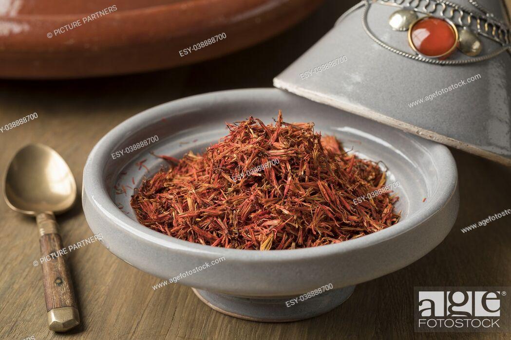 Photo de stock: Traditional bowl with orange dried Moroccan saffron.
