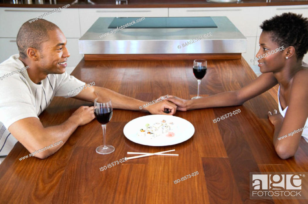 Stock Photo: Couple sitting at dining table.