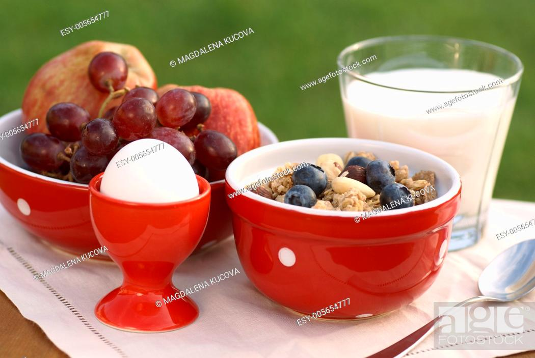 Photo de stock: Bowl with cereal, milk, fruits and egg.