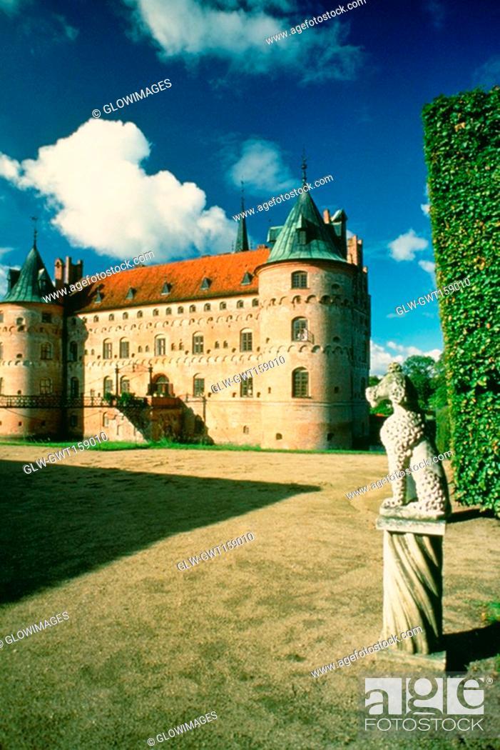 Stock Photo: Statue in the courtyard of a castle, Egeskov Castle, Funen County, Denmark.