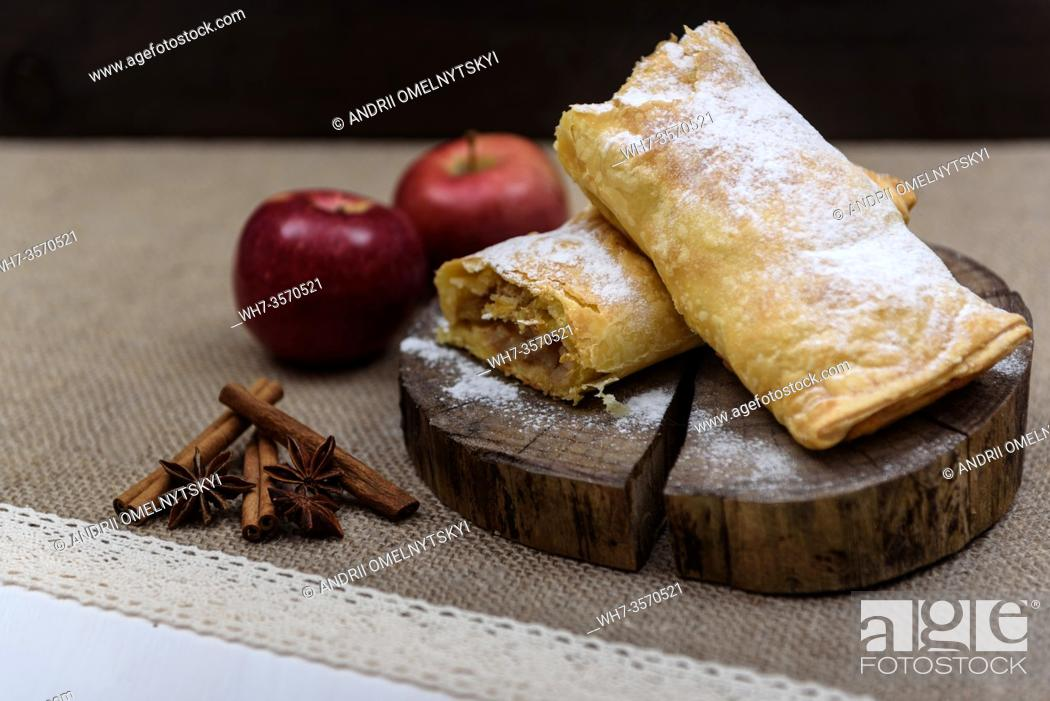 Stock Photo: Apple strudel on wooden end of a tree with apples, cinnamon and star anise.