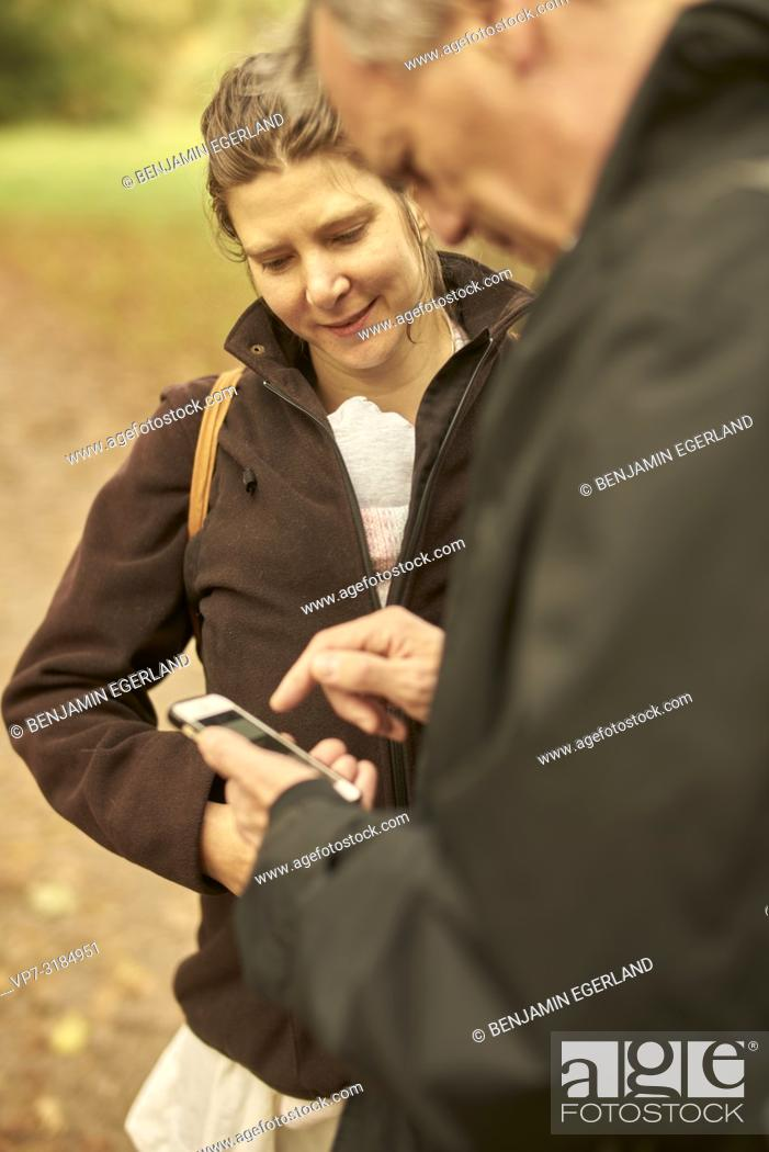 Stock Photo: couple, age difference, outdoors, in park, generations, Grandfather, modern technology, smartphone, navigation, using smartphone, at Neuhofener Berg, Munich.