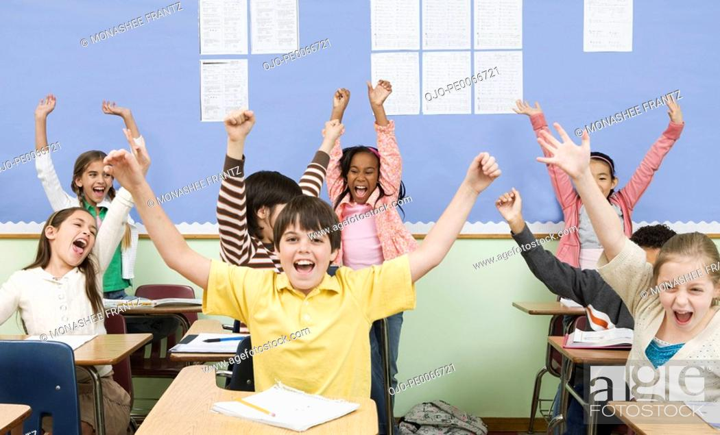 Stock Photo: Students cheering in classroom.