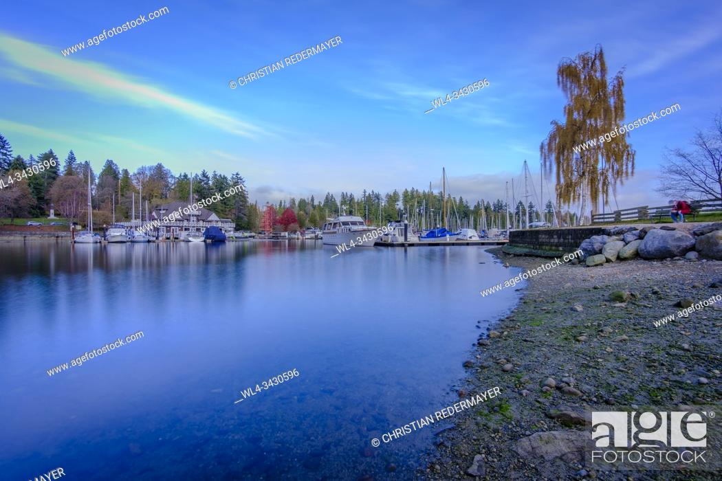 Stock Photo: Coal Harbour in Vancouver, British Columbia during a wonderful sunny afternoon in November and part of Stanley Park behind the boats.