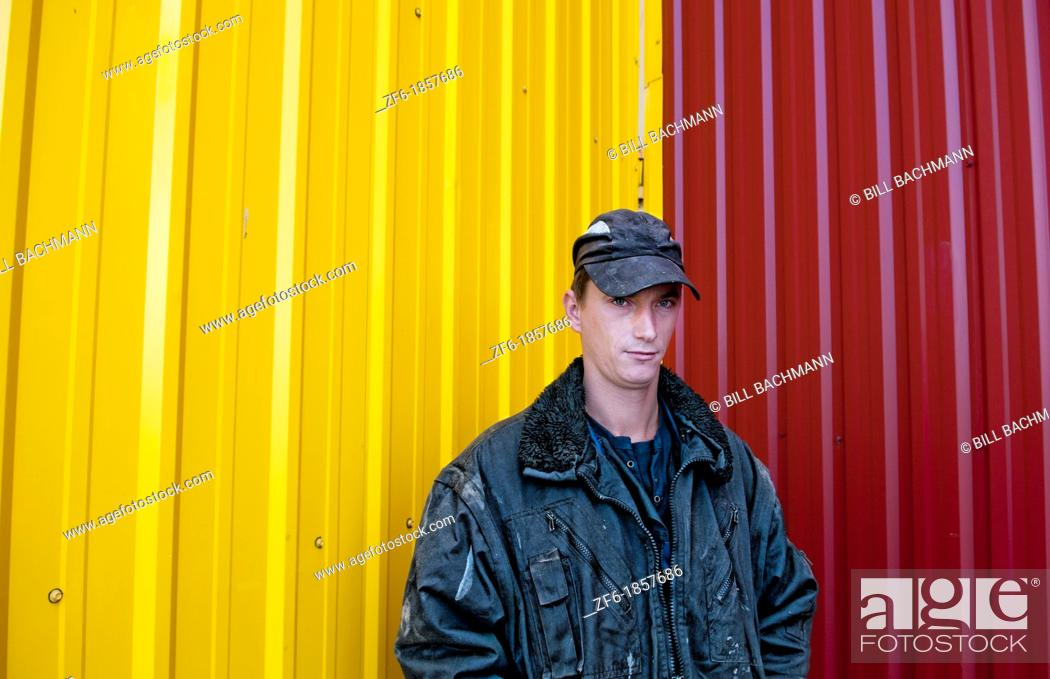 Stock Photo: Trucker portrait Lithuania improvements industry farming with colorful company of wheat farming storage area with trucks in Vaunas Lithuania.