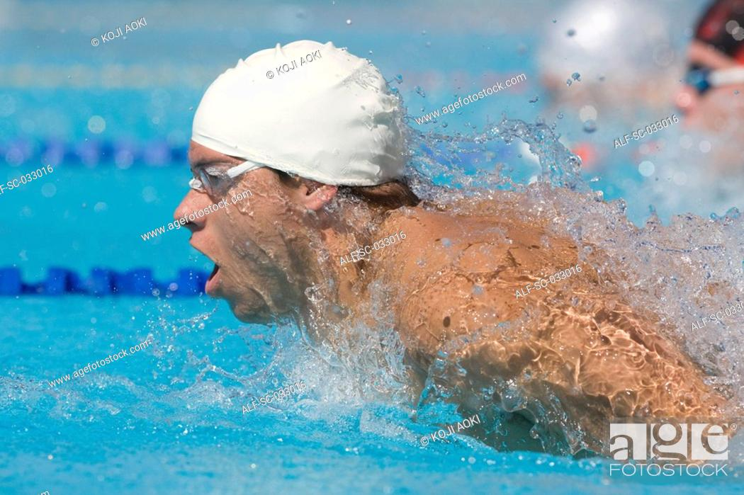 Stock Photo: Young australian breathing while doing butterfly stroke.