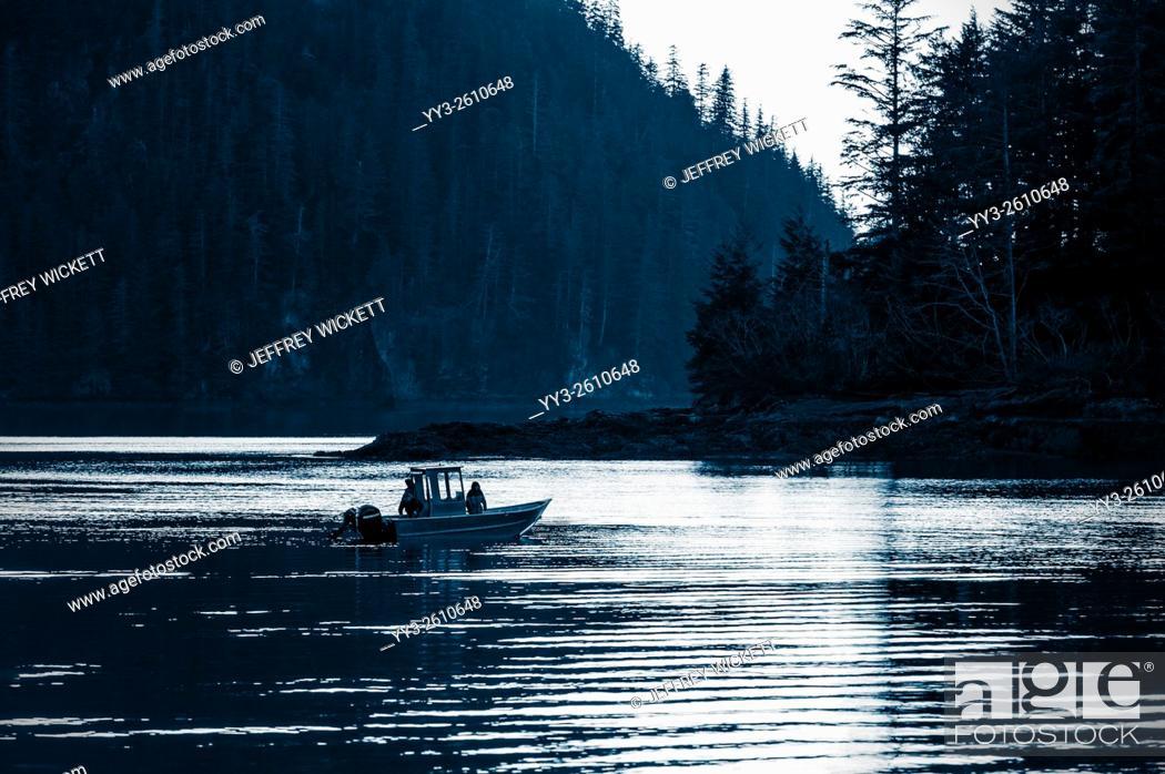 Stock Photo: Fishing on calm Herring Cove waters at sunset near Sitka, Alaska.