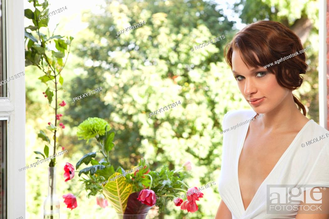 Stock Photo: Young woman looking at camera.