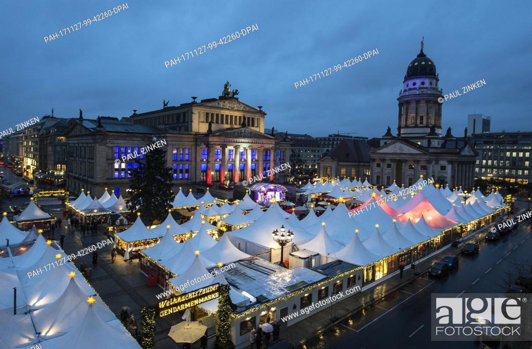 Stock Photo: The Gendarmenmarkt Christmas market glows with light in Berlin, Germany, 27 November 2017. The Christmas market in front of the the Konzerthaus in Berlin opened.