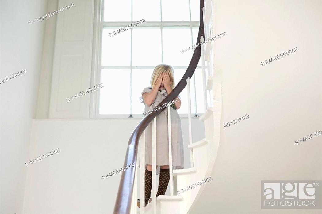 Stock Photo: Girl crying on a stairway.