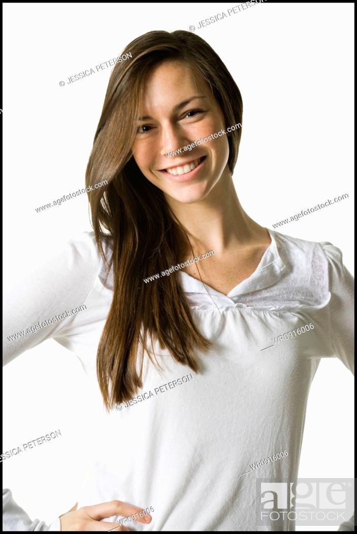 Stock Photo: young woman with a white shirt, smiling.