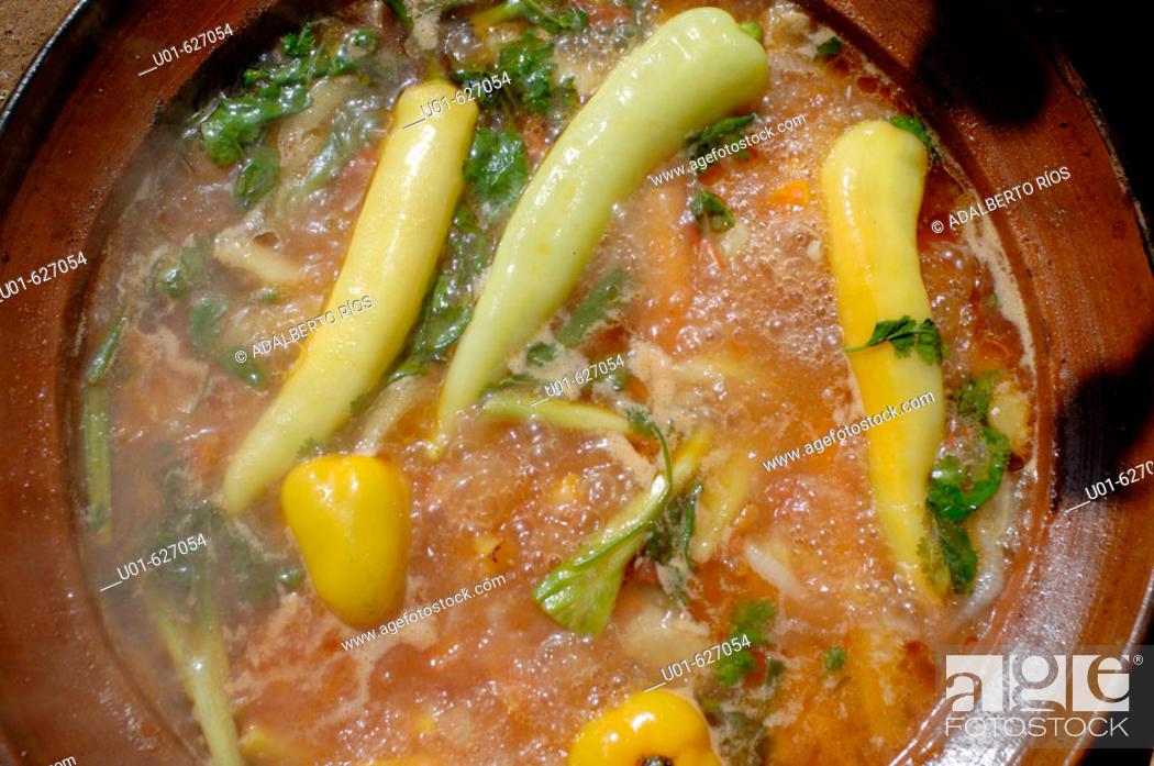 Stock Photo: Preparando una salsa picante. Las salsas picantes son inseparables de los platillos mexicanos. Cada region tiene distintos tipos segun las clases de chiles de.