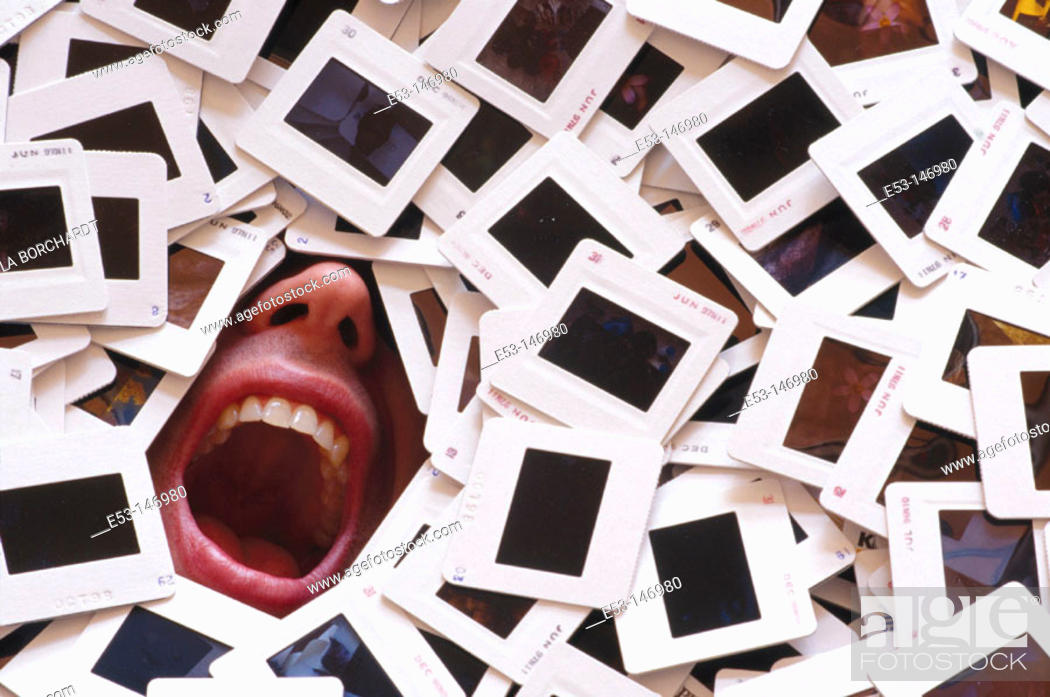 Stock Photo: Man buried under a pile of 35 mm slides.