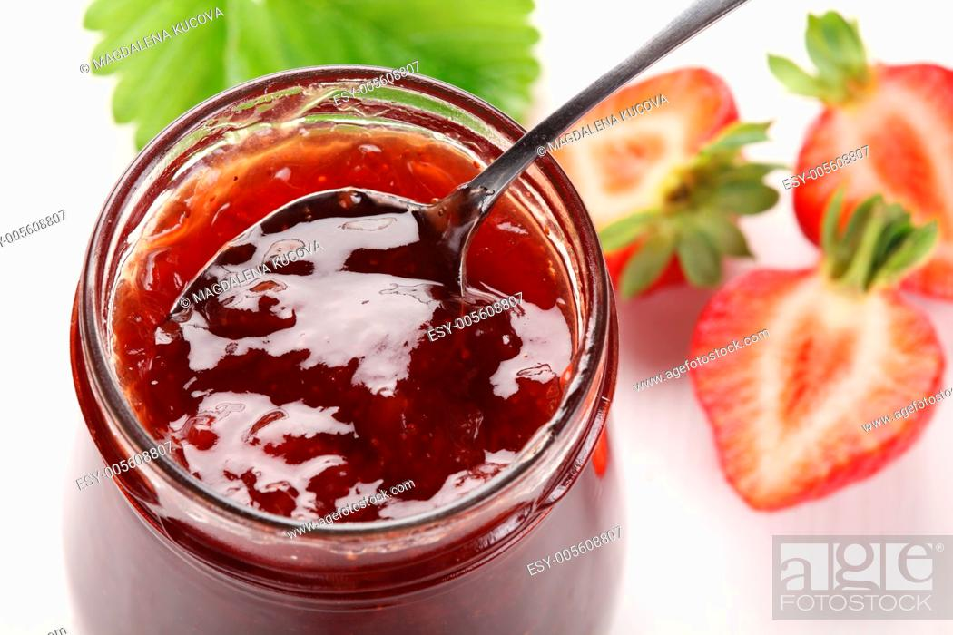 Stock Photo: Glass with strawberry jam and fresh strawberries.