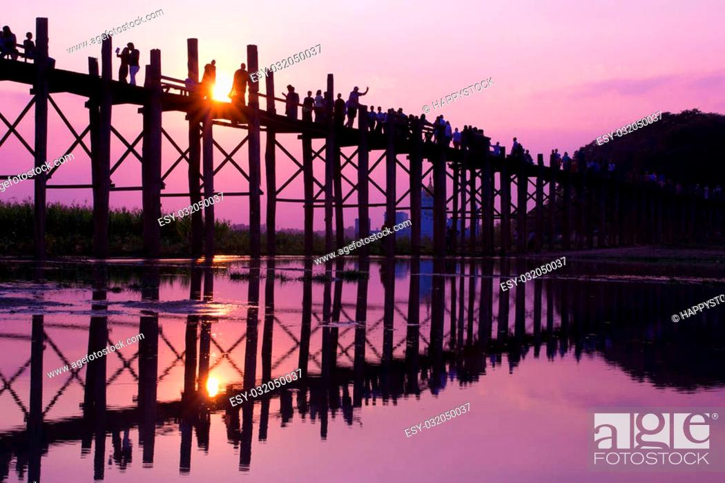 Stock Photo: Silhouette fo people walking at U Bein Bridge, Mandalay, Myanmar.