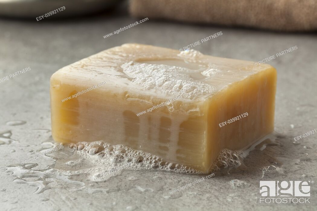 Stock Photo: Wet piece of traditional Moroccan soap with foam for hamam.