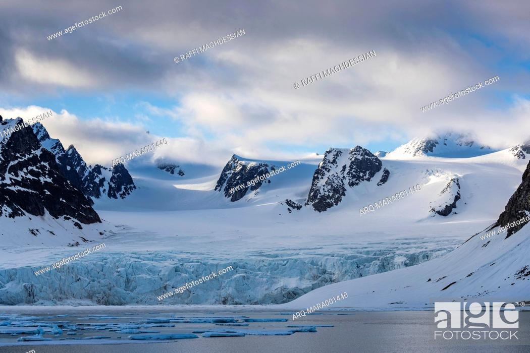 Stock Photo: Beautiful natural scenery of glacier in the Arctic with snowy and rocky mountains in the background, Spitsbergen, Svalbard and Jan Mayen, Norway.