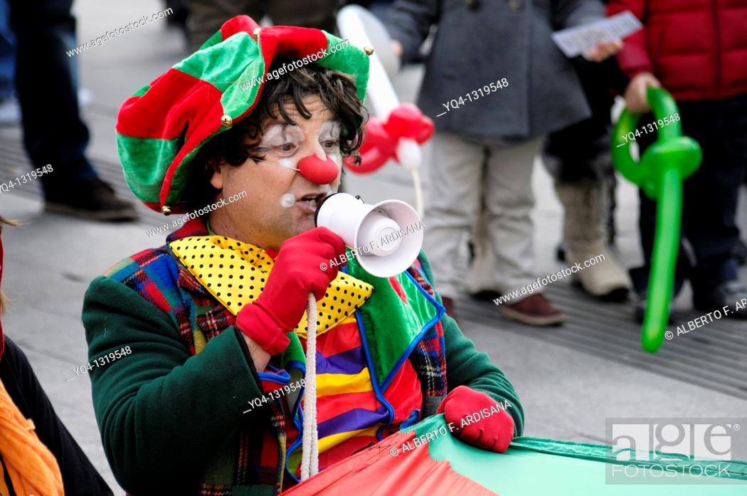 Stock Photo: Street performers, Clowns Without Borders in the Puerta del Sol of Madrid. Spain.