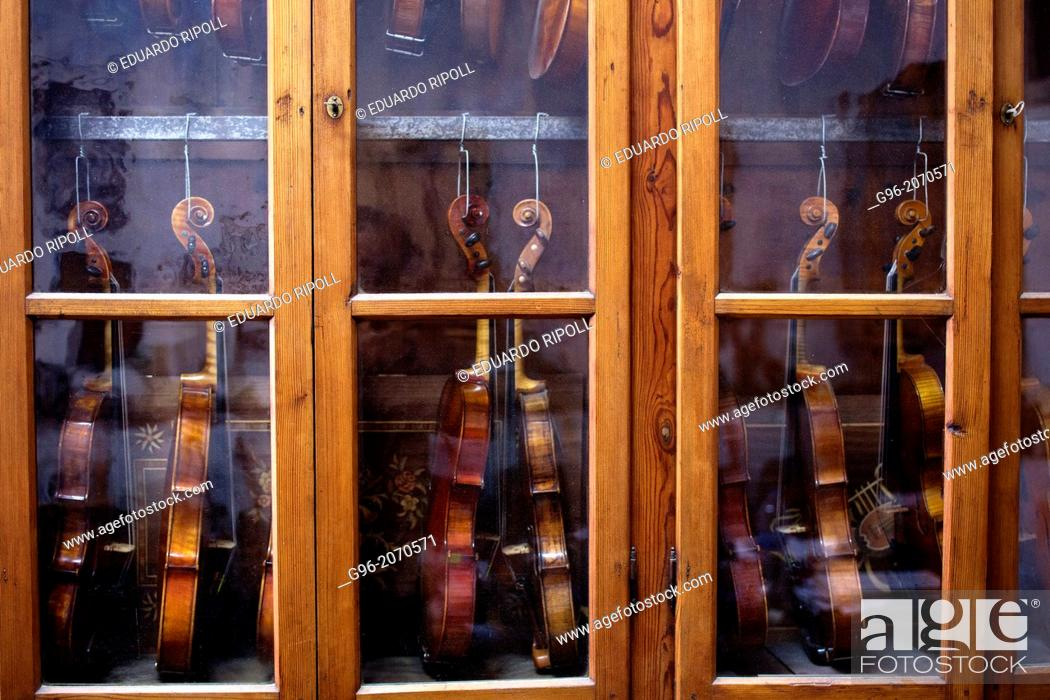 Stock Photo: Violins in a closet.