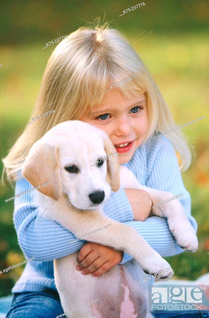 Stock Photo: Girl and her puppy.