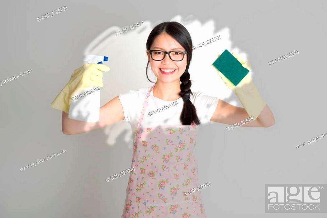 Stock Photo: Woman doing house chores.
