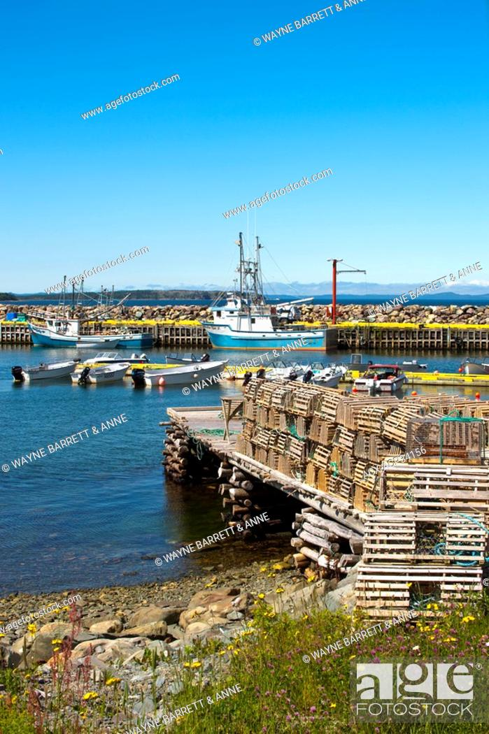 Stock Photo: Lobster traps stacked on the wharf at Green Harbour, Newfoundland and Labrador, Canada.