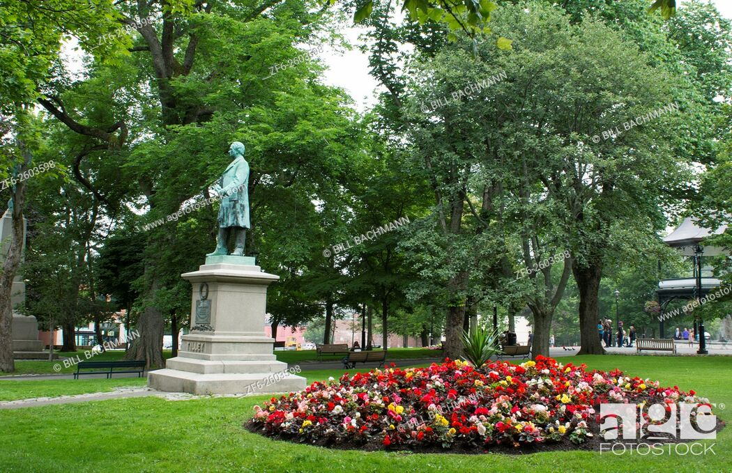 Stock Photo: Canada Saint John New Brunswick Kings Square with flowers and Sir Samuel Leonard Tilley statue and relaxing locals in quiet peaceful park.