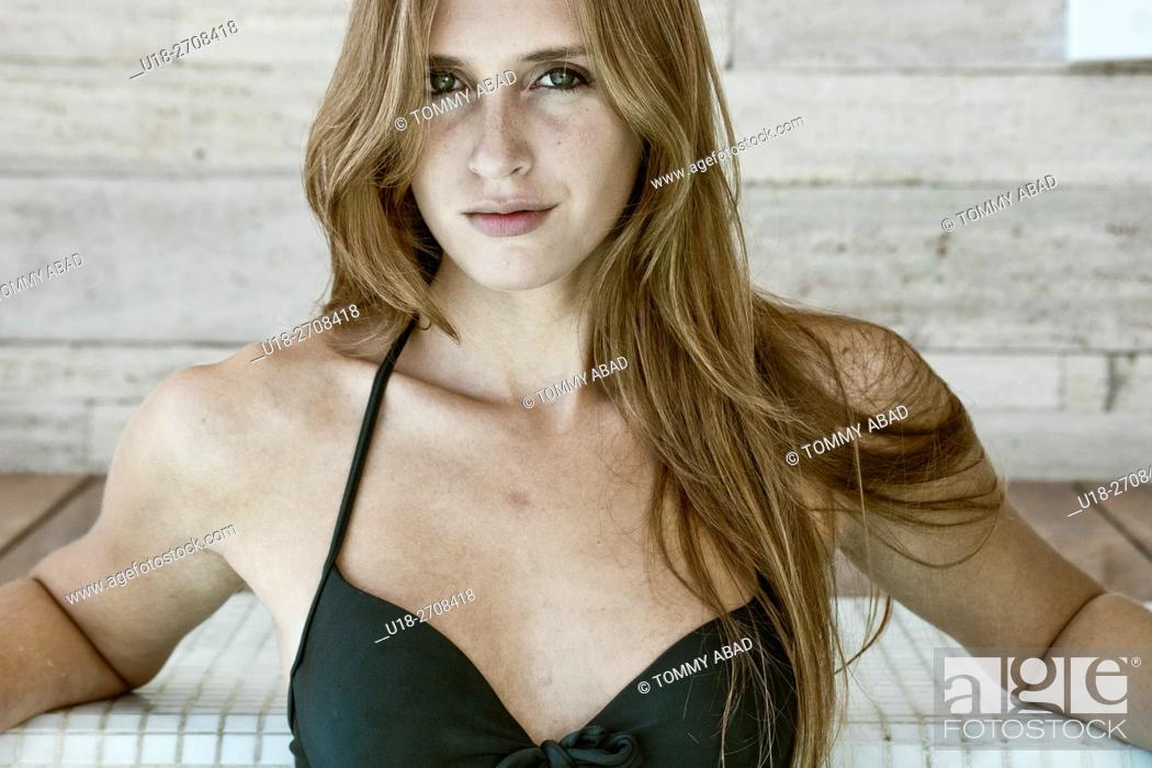Stock Photo: Blonde woman in black bikini.